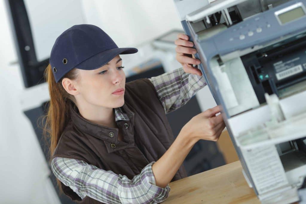 service my photocopy machine? woman servicing office photocopier