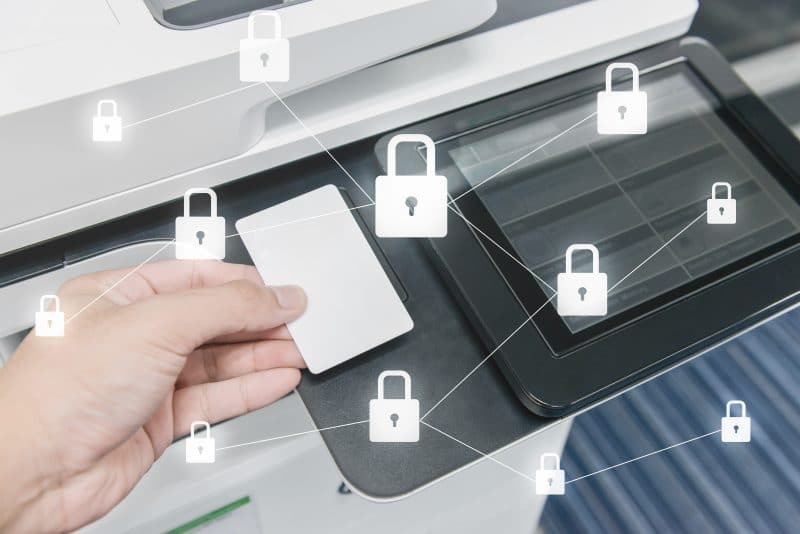 hp secure printing - image shows lock icons around an office printer with a hand using an ID card to secure print job