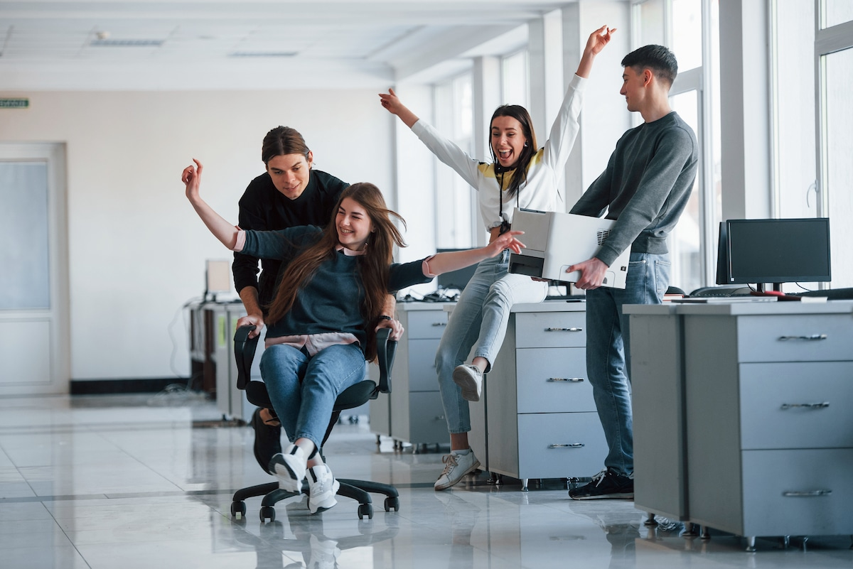 man holds printer having fun in the office young p QDFCE6T